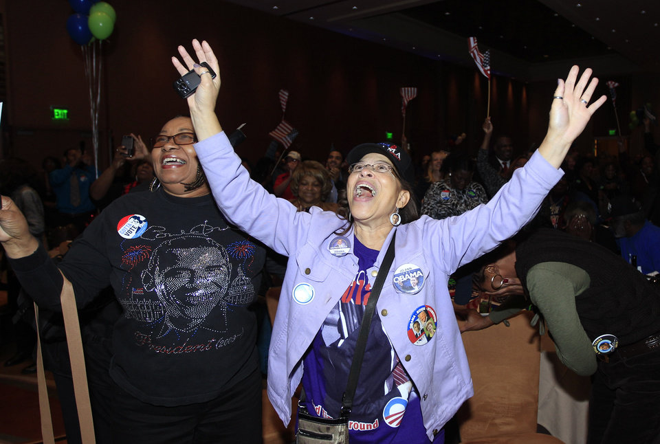 Anita Flanigan, left, and JoAnn Wright react after President Barack Obama reaches the 270 Electoral College votes during the Michigan Democratic election night party at the MGM Grand Detroit, following Election Day, early Wednesday, Nov. 7, 2012. (AP Photo/Carlos Osorio)