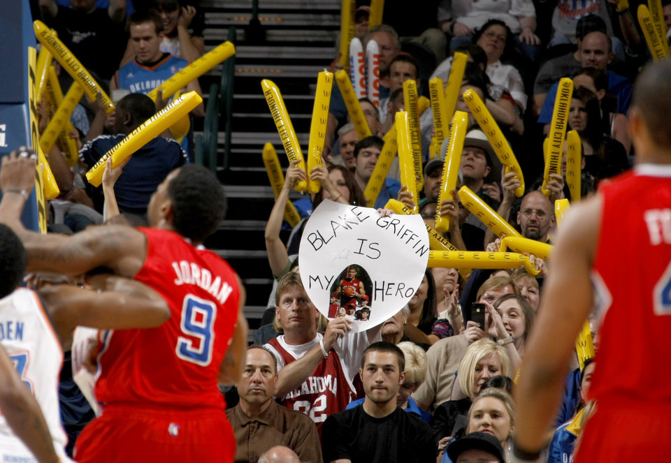 Photo - A fan cheers for Los Angeles Clippers' Blake Griffin (32) during the NBA basketball game between the Oklahoma City Thunder and the Los Angeles at the Oklahoma City Arena, Wednesday, April 6, 2011. Photo by Bryan Terry, The Oklahoman