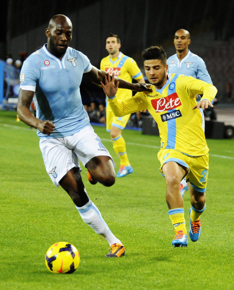 Photo - Napoli's Lorenzo Insigne, right, is chased by Lazio's Michaël Ciani, during an Italian Cup Cup quarterfinal soccer match between Napoli and Lazio, at the San Paolo stadium in Naples, Italy, Wednesday, Jan. 29, 2014. (AP Photo/Salvatore Laporta)