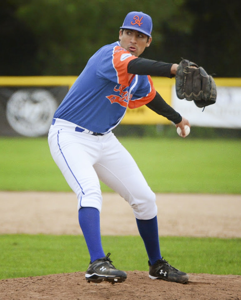 Photo - In this July 19, 2014, photo provided by the Hyannis Athletic Association, Hyannis ambidextrous pitcher Ryan Perez of Hampshire, Ill., pitches with his left hand against the Brewster Whitecaps at Stonybrook Field in Brewster, Mass. The 20-year-old ambidextrous pitcher from tiny Judson University has blossomed into a potential high-round pick for the 2015 draft with his performances this summer in the prestigious Cape Cod League. (AP Photo/Hyannis Athletic Association, Kelsey Grant)