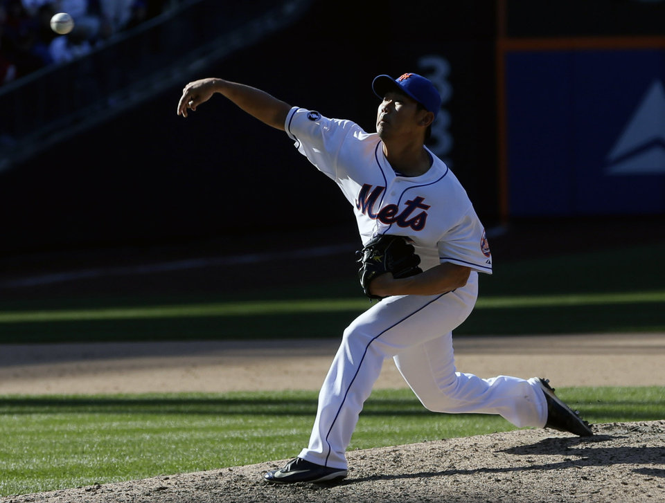 Photo - New York Mets pitcher Daisuke Matsuzaka throws during the eleventh inning of the baseball game against the Atlanta Braves at Citi Field, Sunday, April 20, 2014, in New York. (AP Photo/Seth Wenig)