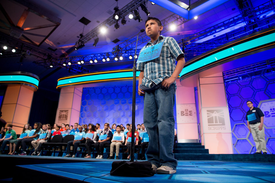 Photo - Kelvin Winney, 10, of Window Rock, Ariz. competes during 2015 Scripps National Spelling Bee, Wednesday, May 27, 2015, at National Harbor in Oxon Hill, Md. (AP Photo/Andrew Harnik)