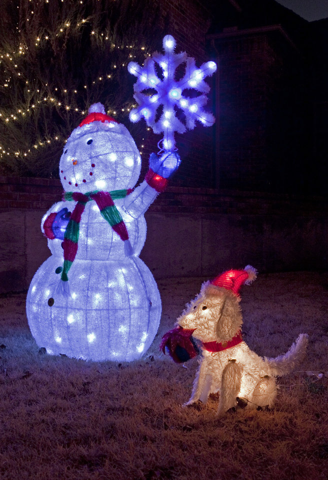 Christmas decorations in front of 4604 Foxborough Ct. light up on Thursday, Dec. 22, 2011, in Norman, Okla.   Photo by Steve Sisney, The Oklahoman
