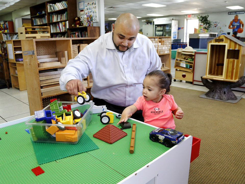 Photo - Landon Gibson with his daughter, Nyriah, at Kinder Castle center in Midwest City. To accompany story on the changing needs of working parents and the growth of 24/7 childcare centers.Thursday, April 6, 2017.   Photo by Jim Beckel, The Oklahoman