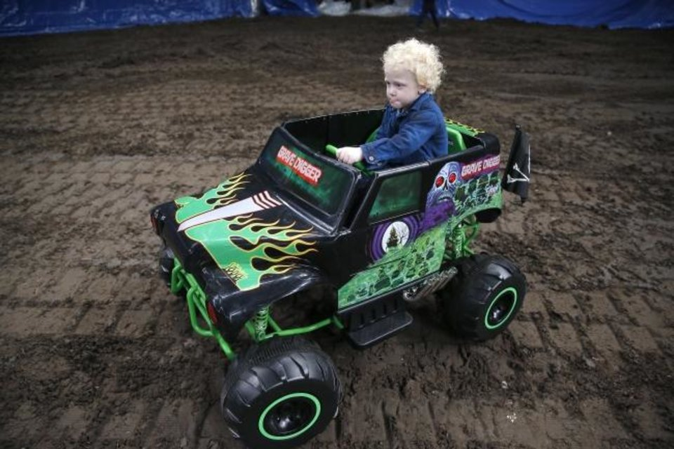 Photo -  Ryker Ammons, 4, of Yukon, Okla., drives around the Monster Jam track at Chesapeake Energy Arena in Oklahoma City, Friday, Feb. 14, 2020.  [Sarah Phipps/The Oklahoman]
