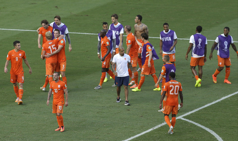 Photo - Netherlands' Wesley Sneijder, front left, smiles after the World Cup round of 16 soccer match between the Netherlands and Mexico at the Arena Castelao in Fortaleza, Brazil, Sunday, June 29, 2014. Holland won 2-1 and advanced to the quarterfinal.  (AP Photo/Themba Hadebe)