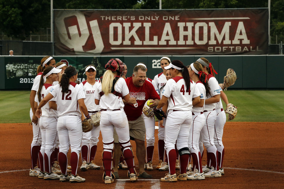 """Photo - Jim Routon, Moore tornado survivor and """"Big Dog"""" in a photograph by Paul Hellstern that appeared following the deadly tornado, threw out the first pitch and celebrates with the team before the University of Oklahoma Sooner (OU) softball team plays Tennessee in the first game of the NCAA super regional at Marita Hynes Field on May 23, 2014 in Norman, Okla. Photo by Steve Sisney, The Oklahoman"""