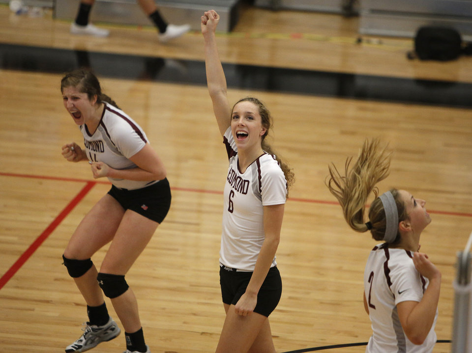 Edmond Memorial's MeKenna Qualls (14) and Jenny Roy (6) celebrate during the OSSAA 6A State Volleyball Championship between Bishop Kelley and Edmond Memorial at Westmoore High School in Moore, Okla., Saturday, Oct. 13, 2012.  Photo by Garett Fisbeck, The Oklahoman