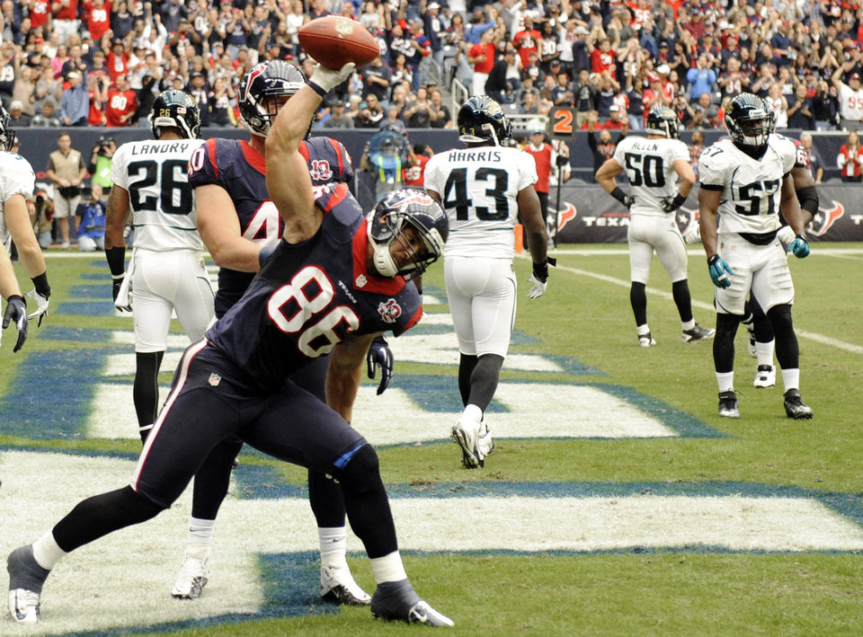 Photo -   Houston Texans fullback James Casey (86) spikes the ball after scoring a touchdown against the Jacksonville Jaguars during the second quarter of an NFL football game, Sunday, Nov. 18, 2012, in Houston. (AP Photo/Dave Einsel)
