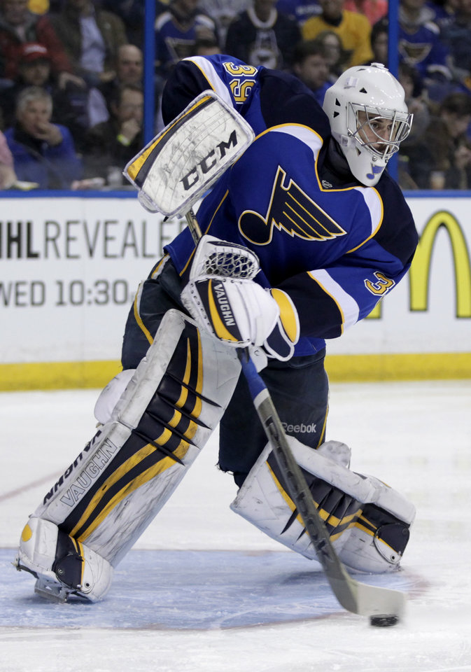 Photo - St. Louis Blues goalie Ryan Miller (39) sweeps away the puck during the first period of an NHL hockey game against the Tampa Bay Lightning, Tuesday, March 4, 2014 in St. Louis.(AP Photo/Tom Gannam)