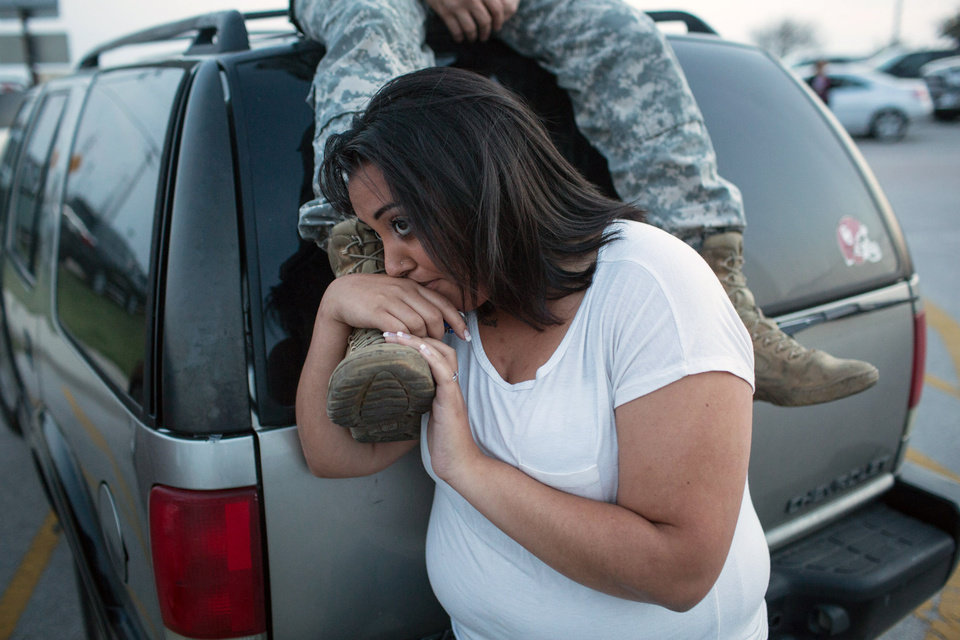 Photo - Lucy Hamlin and her husband, Spc. Timothy Hamlin, wait for permission to re-enter the Fort Hood military base, where they live, following a shooting on the base, Wednesday, April 2, 2014, in Fort Hood, Texas. (AP Photo/ Tamir Kalifa)