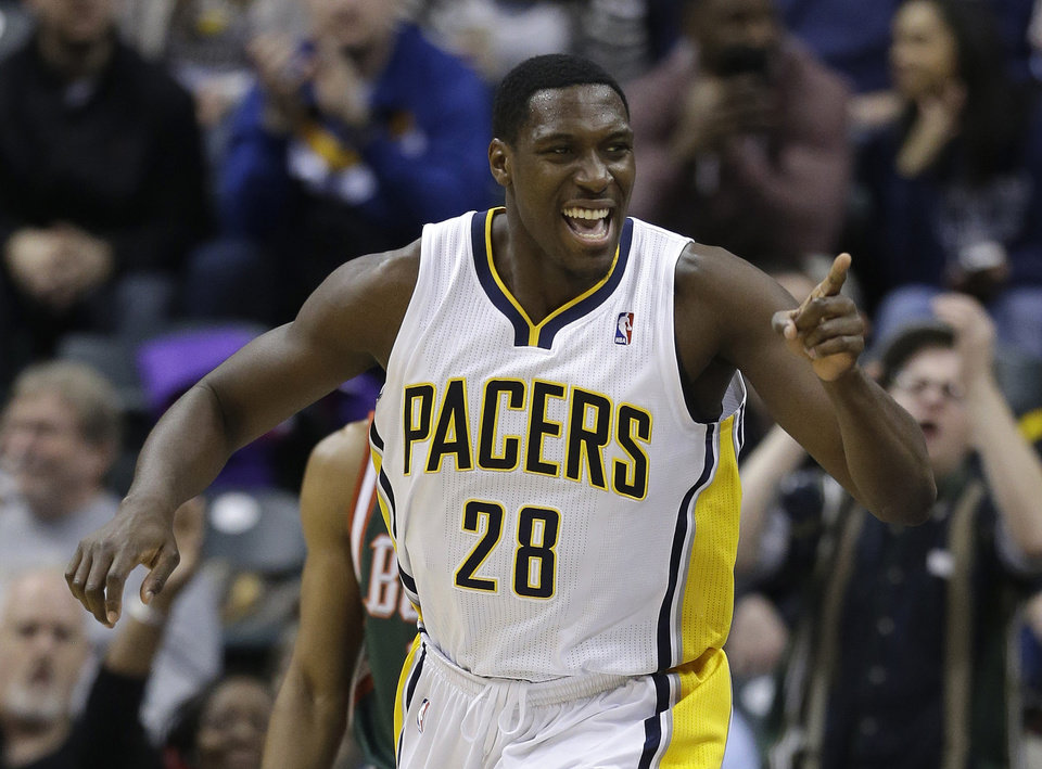 Photo - Indiana Pacers' Ian Mahinmi celebrates following a dunk during the first half of an NBA basketball game against the Milwaukee Bucks, Thursday, Feb. 27, 2014, in Indianapolis. (AP Photo/Darron Cummings)