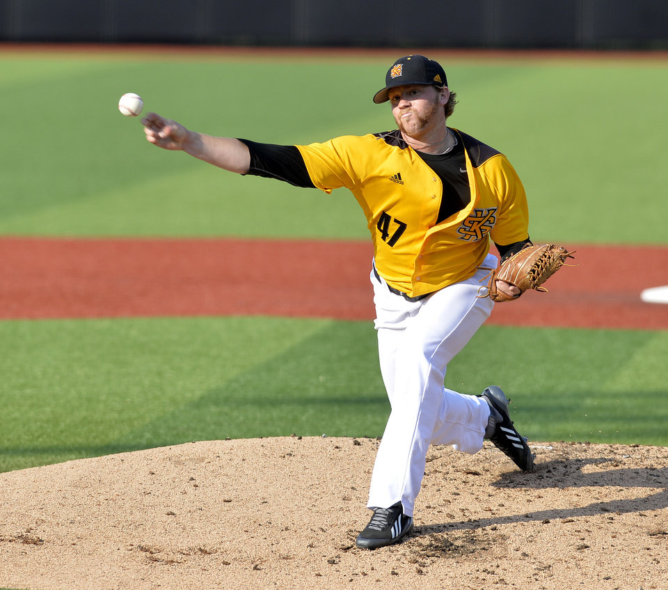 Photo - Kennesaw State's Jordan Hillyer pitches to a Louisville's batter in the first inning of an NCAA college baseball tournament super regional game in Louisville, Ky., Friday, June 6, 2014. (AP Photo/Timothy D. Easley)