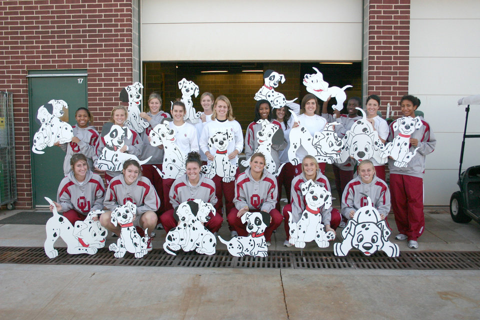 Eighteen members of the University of Oklahoma women's soccer team display the finished product from their volunteer project for the J. D. McCarty Center. The soccer team painted 50 of what will eventually be 101 Dalmatians for a Christmas scene at the hospital. The McCarty Center is a pediatric rehab hospital for children with developmental disabilities in Norman.<br/><b>Community Photo By:</b> Greg Gaston<br/><b>Submitted By:</b> Greg, Norman