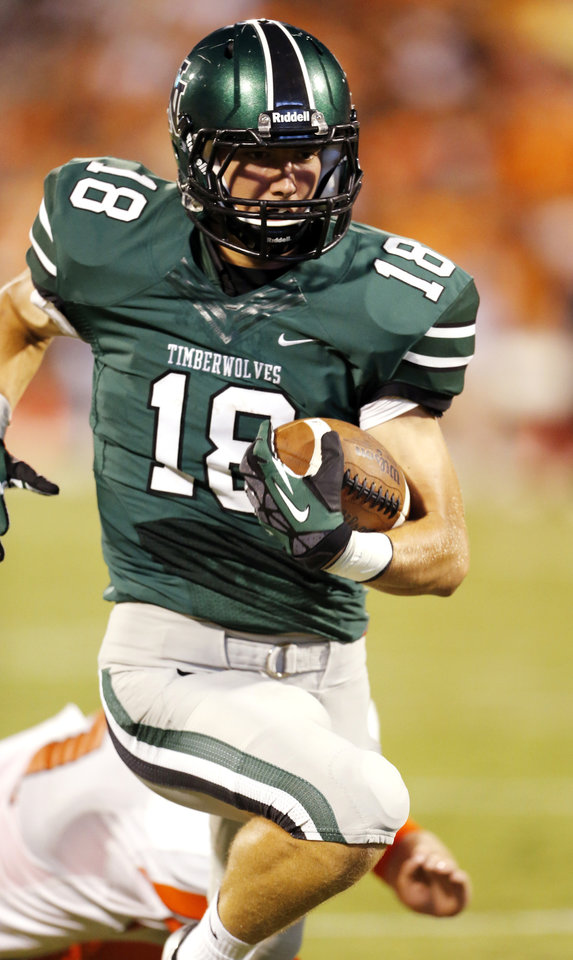 Norman North's Tyler Sipe (18) runs to the end zone for  a touchdown pass reception as the Norman High School Tiger football team plays the Norman North Timberwolves at Gaylord Family/Oklahoma Memorial Stadium on Thursday, Aug. 30, 2012 in Norman, Okla.  Photo by Steve Sisney, The Oklahoman