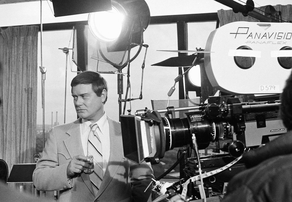Photo -   FILE - This Feb. 2, 1979 file photo shows actor Larry Hagman next to a camera on the set of the television series