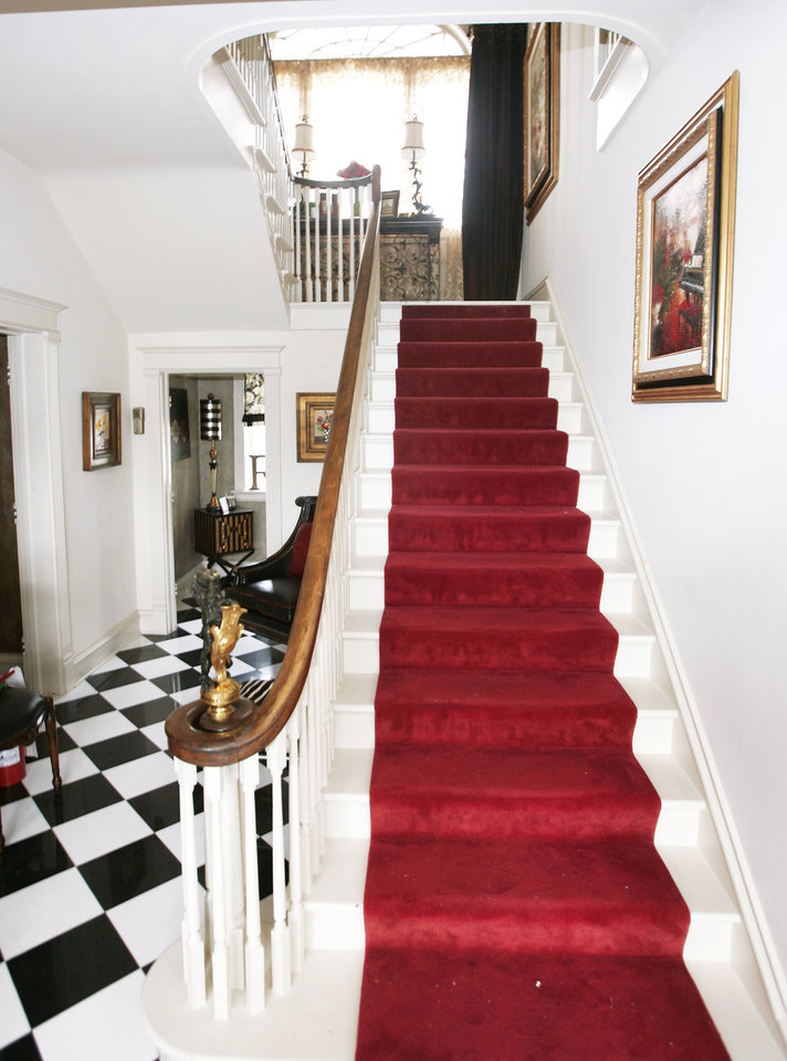 """Photo - Visitors to the Symphony Designers Show House will get a """"red-carpet"""" welcome — the carpet on the stairs at the entry.PHOTO BY STEVE GOOCH, THE OKLAHOMAN"""