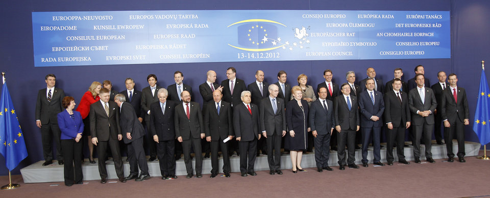 EU heads of state pose for the media, at the start of a two-day EU summit, at the European Council building in Brussels, Thursday, Dec. 13, 2012. In one whirlwind morning, the European Union nations agreed on the foundation of a fully-fledged banking union and Greece�s euro partners approved billions of euros in bailout loans that will prevent the nation from going bankrupt. First row from left to right: EU foreign policy chief Catherine Ashton, Slovakia's Prime Minister Robert Fico, Luxembourg's Prime Minister Jean-Claude Juncker, Italy's Prime Minister Mario Monti, European Parliament President Martin Schulz, Romania's President Traian Basescu, Cypriot President Dimitris Christofias, European Council President Herman Van Rompuy, Lithuania's President Dalia Grybauskaite, French President Francois Hollande, European Commission President Jose Manuel Barroso, Greek Prime Minister Antonis Samaras, Latvian Prime Minister Valdis Dombrovskis, Dutch Prime Minister Mark Rutte, and the Secretary-General of the EU Council Uwe Corsepius. Top row: Croatia's Prime Minister Zoran Milanovic, Denmark's Prime Minister Helle Thorning-Schmidt, Poland's Prime Minister Donald Tusk, Hungarian Prime Minister Viktor Orban, Belgium's Prime Minister Elio Di Rupo, Spain's Prime Minister Mariano Rajoy, Swedish Prime Minister Fredrik Reinfeldt, Czech Republic's Prime Minister Petr Necas, Slovenia's Prime Minister Janez Jansa, Portugal's Prime Minister Pedro Passos Coelho, German Chancellor Angela Merkel, Finland's Prime Minister Jyrki Katainen, Austrian Chancellor Werner Faymann, Bulgarian Prime Minister Boyko Borissov, Estonia's Prime Minister Andrus Ansip, British Prime Minister David Cameron, and Malta's Prime Minister Lawrence Gonzi. (AP Photo/Michel Euler)