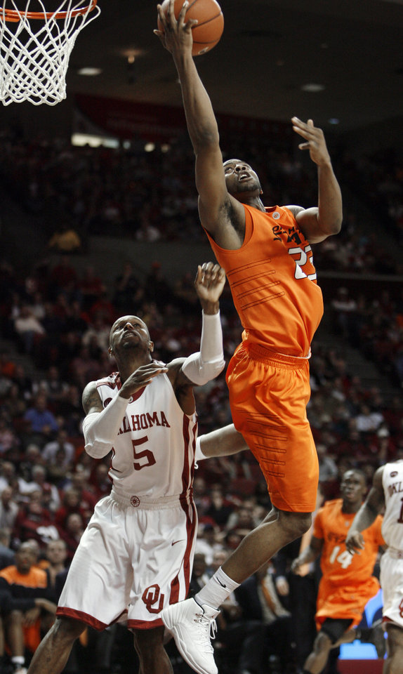 Photo - James Anderson (23) shoots over Tony Crocker (5) during the second half of the college bedlam basketball game in which The University of Oklahoma Sooners (OU) defeated Oklahoma State University University Cowboys (OSU) 62-57 in overtime at the Lloyd Noble Center on Monday, Jan. 11, 2010, in Norman, Okla.