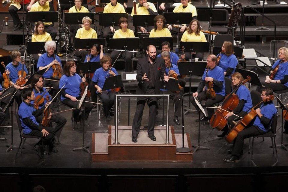 Photo - The Oklahoma City Philharmonic's education conductor, Matthew Troy speaks to the audience during an educational concert for schoolchildren by the orchestra on Wednesday, Nov. 11, 2015 in Oklahoma City, Okla. [The Oklahoman Archives]