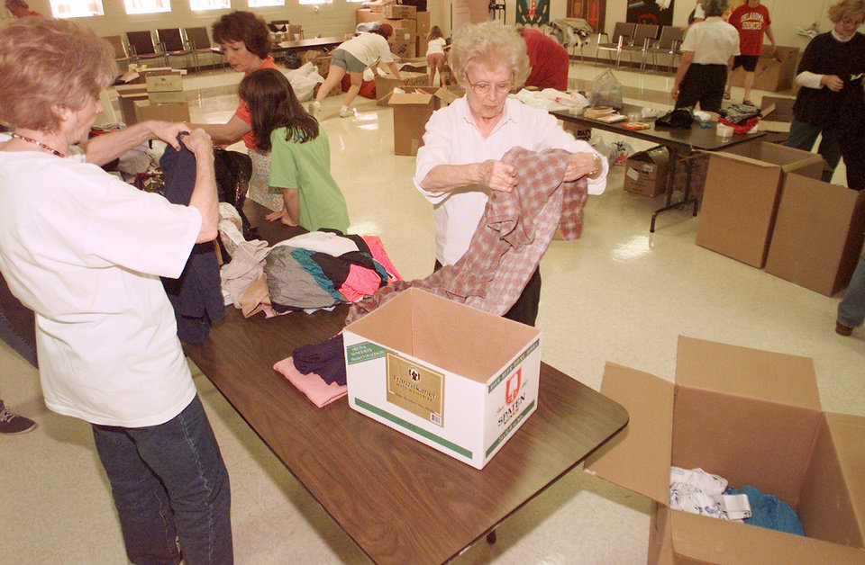 MAY 3, 1999 TORNADO: Donations: First Presbyterian Church member Vivian Hamilton separates clothes along with other volunteers. Many items were donated to help the victims of the Monday tornado.