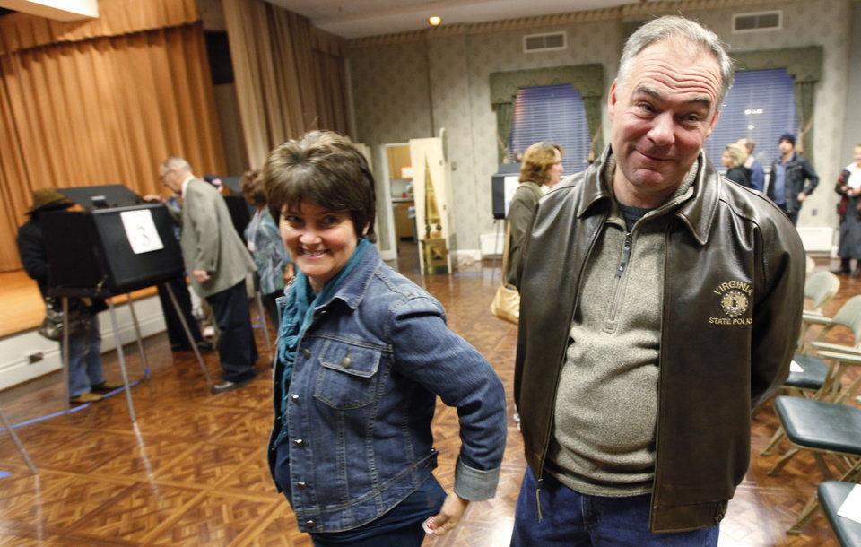 Democratic Senate candidate, former Gov. Timothy Kaine, and his wife, Anne Holton, wait in line to vote on Election Day in Richmond, Va., Tuesday, Nov. 6, 2012. (AP Photo/Steve Helber)