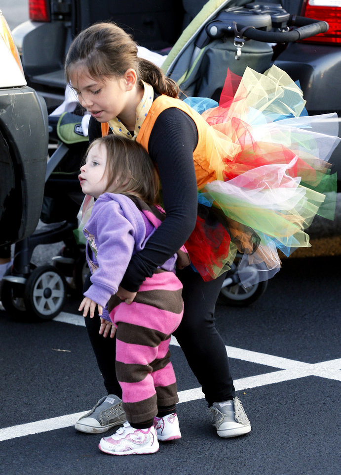 Brynn McMillan, 9, and sister Elliot McMillan, 18 months, arrive in costume for the Monster Dash.