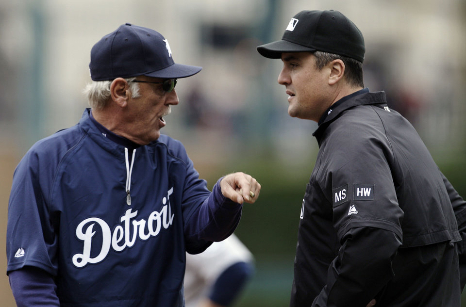 Photo -   Detroit Tigers manager Jim Leyland, left, argues with first base umpire Mike DiMuro after Gerald Laird was called out at first base during the third inning of a baseball game against the Seattle Mariners in Detroit, Thursday, April 26, 2012. (AP Photo/Paul Sancya)