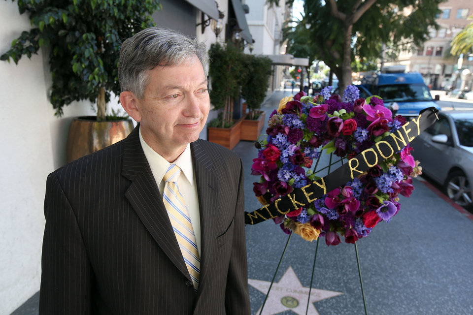 Photo - Hollywood Chamber President Leron Gubler speaks to the media after flowers are placed on the Hollywood Walk of Fame star of Hollywood legend, Mickey Rooney, on Vine Street on Monday, April 7, 2014, in the Hollywood section of Los Angeles. The iconic actor, Rooney, died at 93 on Sunday, April 6, 2014. Over a four-decade span, he was nominated for four Academy Awards ,and received two special Oscars for film achievements, won an Emmy for his TV movie