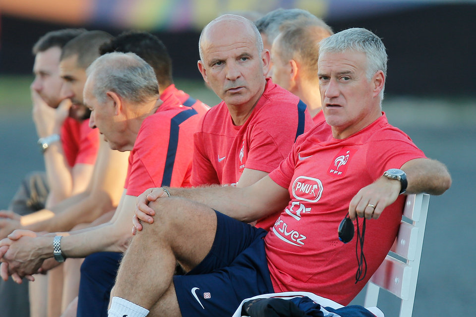 Photo - France's head coach Didier Deschamps sits on the bench next to his assistant, Guy Stephan, during a training session at the Santa Cruz stadium, in Ribeirao Preto, Brazil, Saturday, June 21, 2014. Having captured people's attention at the soccer World Cup with some scintillating attacking football, France's players are now in unknown territory after raising expectations back home, having routed Switzerland and Honduras. (AP Photo/David Vincent)
