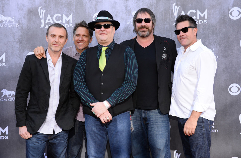 Photo - The musical group Blues Traveler arrives at the 49th annual Academy of Country Music Awards at the MGM Grand Garden Arena on Sunday, April 6, 2014, in Las Vegas. (Photo by Al Powers/Powers Imagery/Invision/AP)