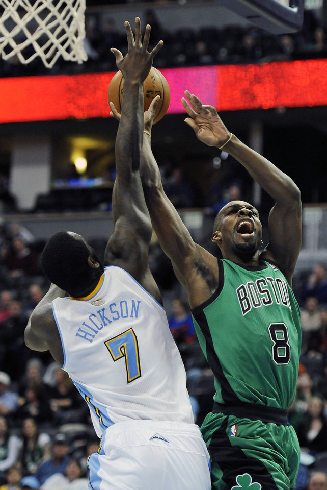 Photo - Boston Celtics forward Jeff Green, right, is fouled by Denver Nuggets forward J.J. Hickson in the first half of an NBA basketball game on Tuesday, Jan. 7, 2014, in Denver. (AP Photo/Chris Schneider)