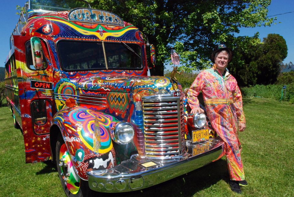 Photo - In a May 14, 2014 photo, Zane Kesey poses with the latest version of the psychedelic bus Further in Pleasant Hill, Ore. Kesey is raising money on Kickstarter to put the bus on the road to commemorate the 50th anniversary of the 1964 LSD-fueled bus trip by his late father, author Ken Kesey, and his pals, the Merry Pranksters. (AP Photo/Jeff Barnard) \