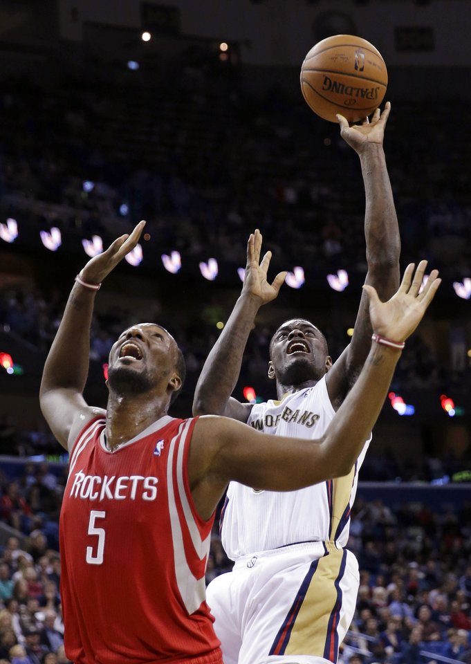 New Orleans Pelicans guard Anthony Morrow shoots in front of Houston Rockets forward Jordan Hamilton (5) in the second half of an NBA basketball game in New Orleans, Wednesday, April 16, 2014. The Pelicans won 105-100. (AP Photo/Gerald Herbert)