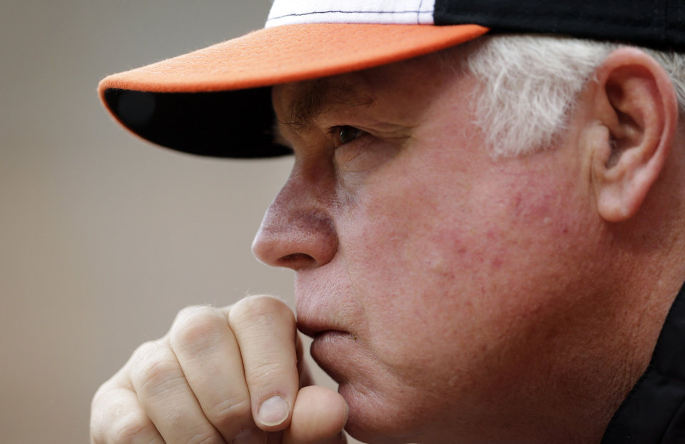 Photo - Baltimore Orioles manager Buck Showalter watches from the dugout in the fourth inning of the first baseball game of a doubleheader against the Pittsburgh Pirates, Thursday, May 1, 2014, in Baltimore. (AP Photo/Patrick Semansky)