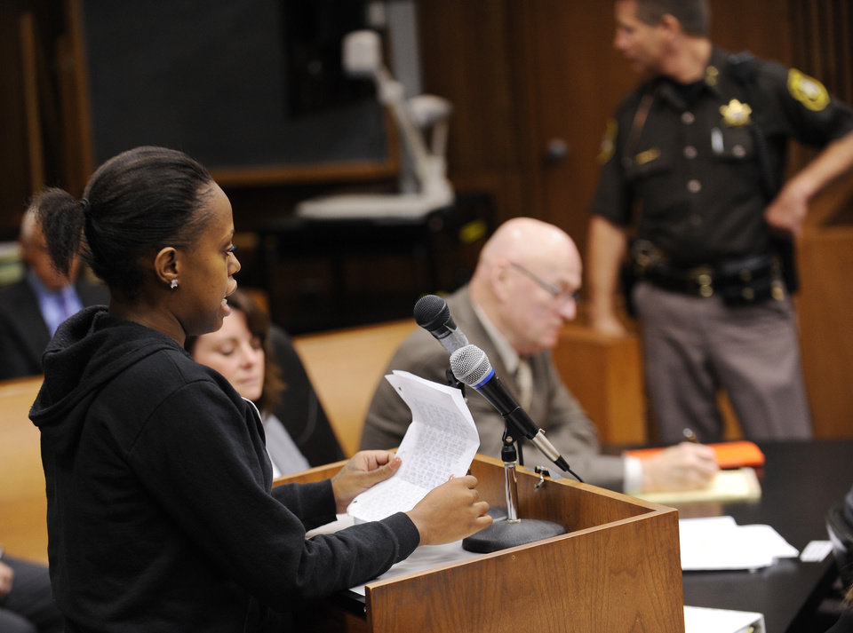 Photo - Jasmine McBride, 23, sister of Renisha, McBride reads an impact statement before the court during the sentencing hearing for Theodore Wafer, Wednesday, Sept. 3, 2014, 2014, in Detroit. Wafer was sentenced to at least 17 years in prison on Tuesday for killing an unarmed Renisha McBride on his porch. During the trial, he said he shot the 19-year-old because he feared for his life, but a jury rejected Wafer's claim of self-defense. (AP Photo/Detroit News, Clarence Tabb Jr.)  DETROIT FREE PRESS OUT; HUFFINGTON POST OUT, MANDATORY CREDIT