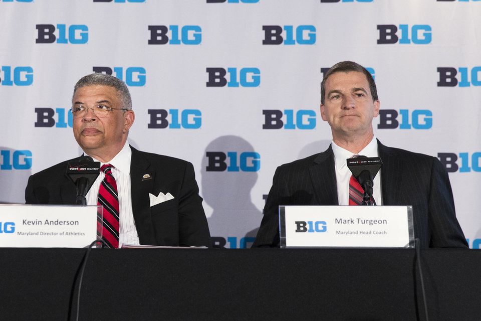 Photo - File- This May 6, 2014, file photo shows Maryland head basketball coach Mark Turgeon, right, sitting with Maryland athletic director Kevin Anderson during a news conference announcing the 2017 Big Ten Conference men's basketball  tournament will be held in Washington in Washington. The musical chairs of conference realignment returns this this week, with more major colleges taking new seats. On Tuesday, July 1, 2014, 12 FBS teams officially switch places, including Louisville in the Atlantic Coast Conference and Maryland and Rutgers in the Big Ten. (AP Photo/ Evan Vucci, File)