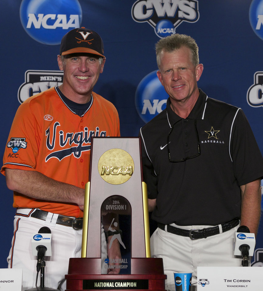 Photo - Virginia coach Brian O'Connor, left, and Vanderbilt coach Tim Corbin pose with the College World Series trophy prior to a news conference on Sunday, June 22, 2014, ahead of the NCAA baseball College World Series finals between the teams which begin on Monday at TD Ameritrade Park in Omaha, Neb. (AP Photo/Nati Harnik)