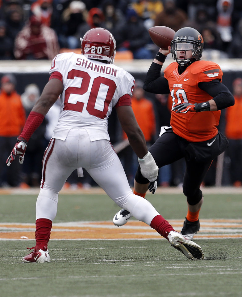 Photo - Oklahoma State's Clint Chelf (10) looks to throw the pass as Oklahoma's Frank Shannon (20) pressures him during the Bedlam college football game between the Oklahoma State University Cowboys (OSU) and the University of Oklahoma Sooners (OU) at Boone Pickens Stadium in Stillwater, Okla., Saturday, Dec. 7, 2013. OU won 33-24. Photo by Sarah Phipps, The Oklahoman