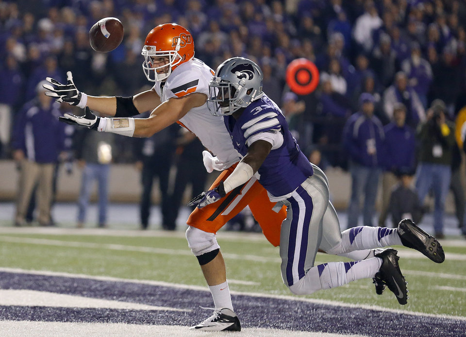 Kansas State\'s Allen Chapman (3) breaks up a pass intended for Oklahoma State\'s Charlie Moore (17) during the college football game between Kansas State University (KSU) and Oklahoma State (OSU) at Bill Snyder Family Football Stadium in Manhattan, Kan., Saturday, Nov. 3, 2012. Photo by Sarah Phipps, The Oklahoman