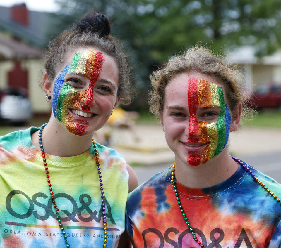 Photo - Kylie Hagerdon, left, and Lindsey Chaffin pose for a portrait to show their rainbow face paint at the OKC Pride Parade on NW 39  in Oklahoma City, Sunday, June 26, 2016. Photo by Kurt Steiss, The Oklahoman