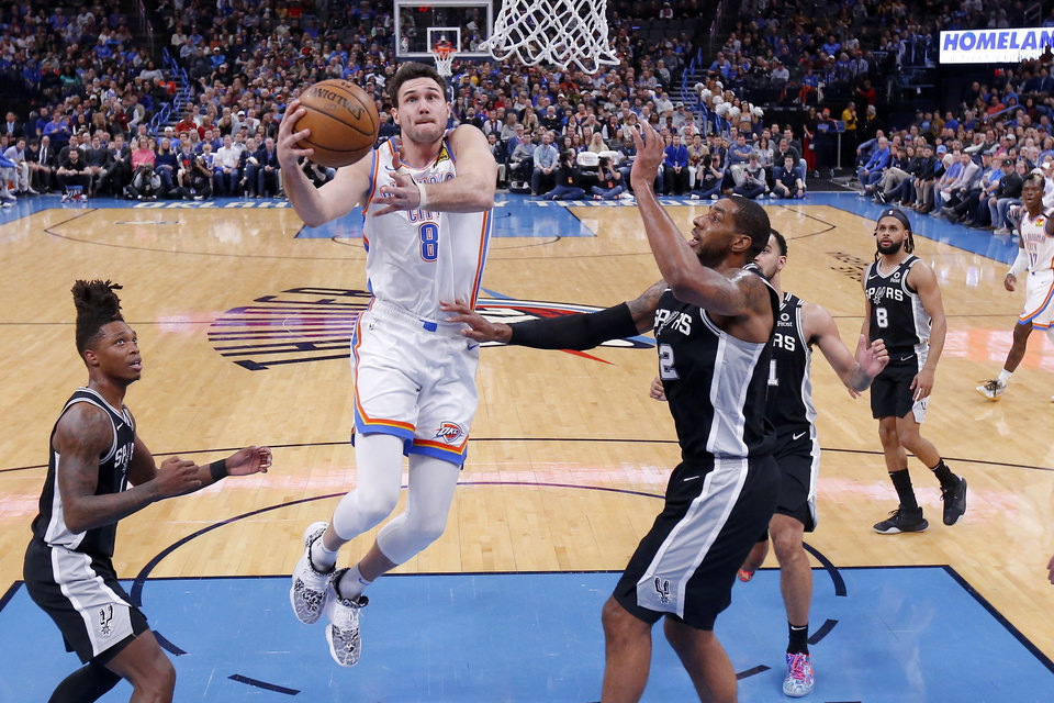 Photo - Oklahoma City's Danilo Gallinari (8) goes to the basket between San Antonio's Lonnie Walker IV (1) and LaMarcus Aldridge (12) during an NBA basketball game between the Oklahoma City Thunder and the San Antonio Spurs at Chesapeake Energy Arena in Oklahoma City, Tuesday, Feb. 11, 2020. San Antonio won 114-106. [Bryan Terry/The Oklahoman]