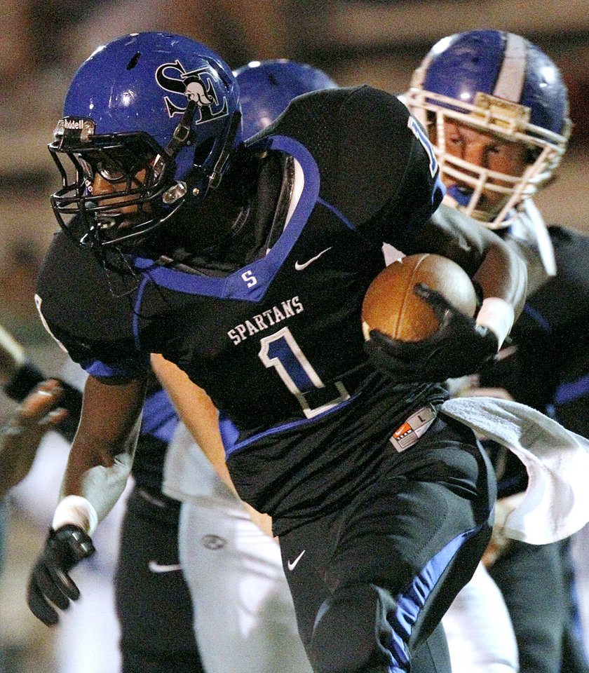 Southeast high school\'s running back Tyliq Brazille takes the ball downfield against Deer Creek during their high school football game at C.B. Speegle Stadium in south Oklahoma City on Thursday, September 29, 2011. Photo by John Clanton, The Oklahoman