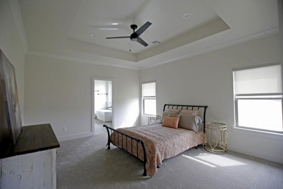 Photo -  The master bedroom at 2215 Kimball Drive in Norman, built by Cougar Homes. [BRYAN TERRY/THE OKLAHOMAN]