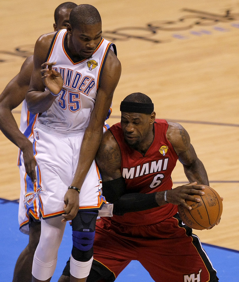 Miami's LeBron James (6) tries to get past Oklahoma City's Kevin Durant (35) during Game 1 of the NBA Finals between the Oklahoma City Thunder and the Miami Heat at Chesapeake Energy Arena in Oklahoma City, Tuesday, June 12, 2012. Photo by Sarah Phipps, The Oklahoman