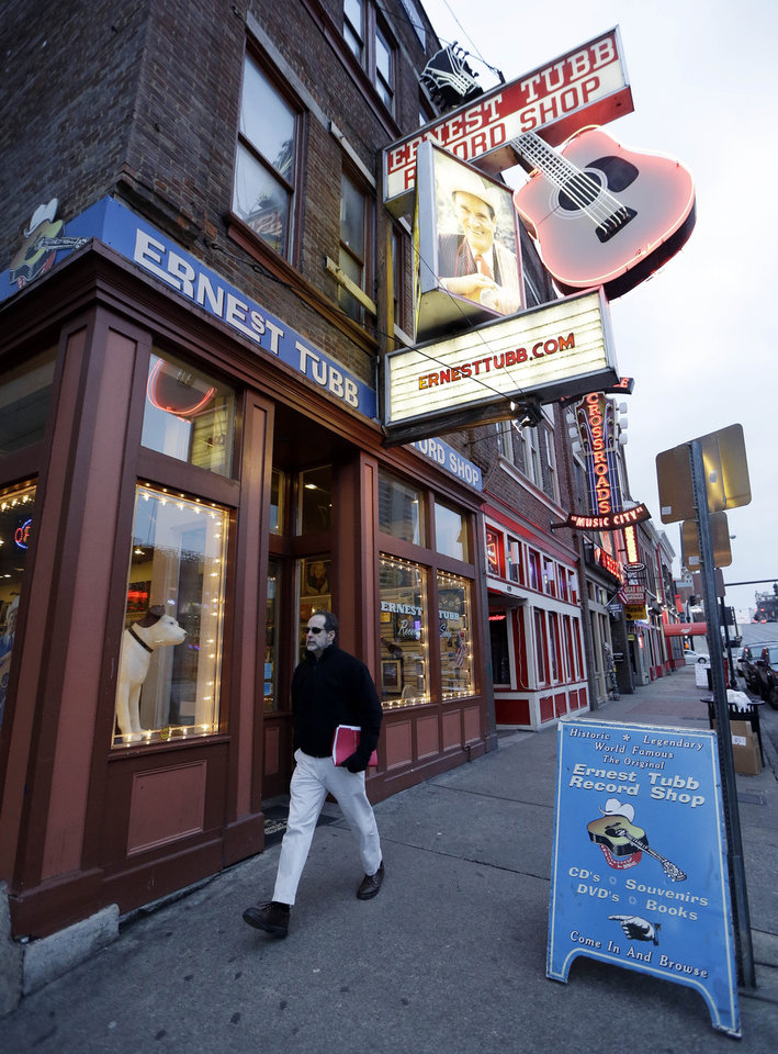 Photo - This Jan. 15, 2014 photo shows the Ernest Tubb Record Shop in Nashville, Tenn. The store, which contains hard to find recordings and also features live shows, is located on lower Broadway, the home of honky tonks and street musicians. (AP Photo/Mark Humphrey)
