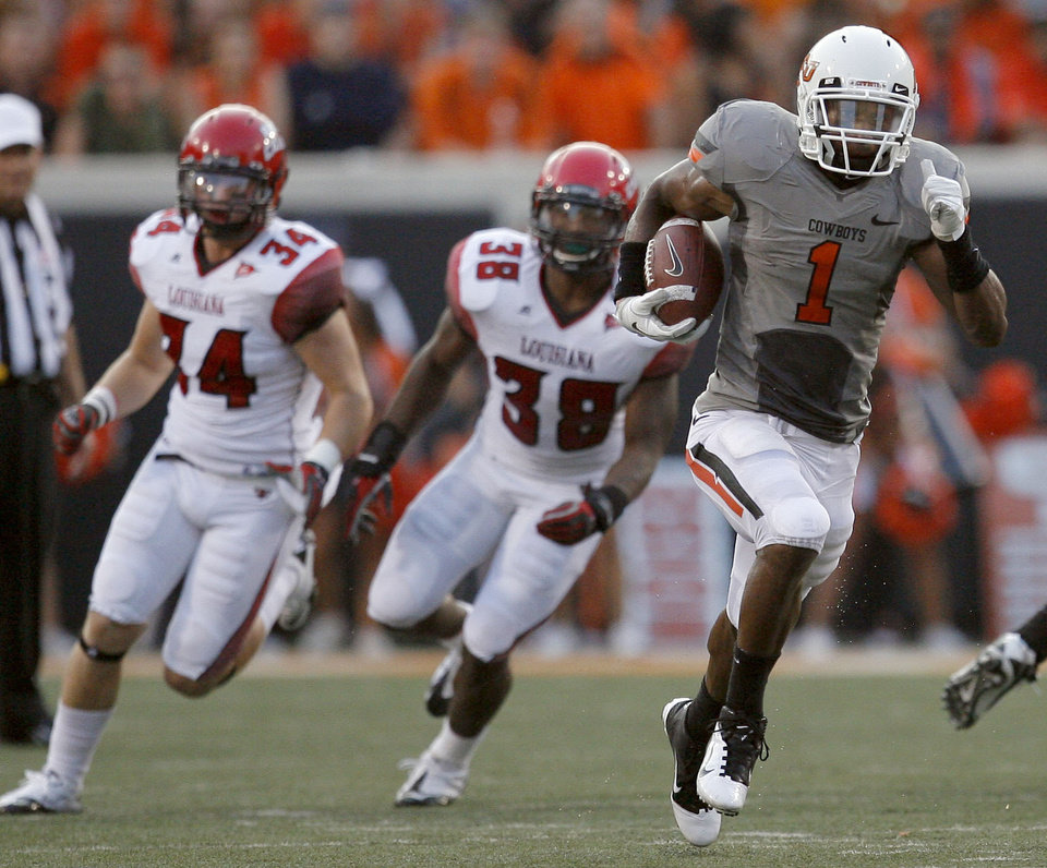 Photo - Oklahoma State's Joseph Randle runs up field as Louisiana-Lafayette's Justin Anderson, left, and Brandon Johnson chase him down during their game Saturday. Photo by Sarah Phipps, The Oklahoman