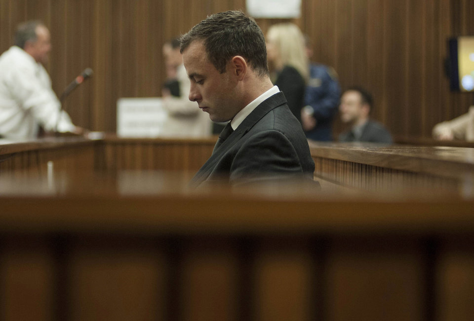 Photo - Oscar Pistorius is seated inside a courtroom in Pretoria, South Africa, June 30, 2014. The murder trial of Pistorius resumed Monday,  after one month during which mental health experts evaluated the athlete to determine if he has an anxiety disorder that could have influenced his actions on the night he killed his girlfriend Reeva Steenkamp. (AP Photo/Ihsaan Haffejee, Pool)
