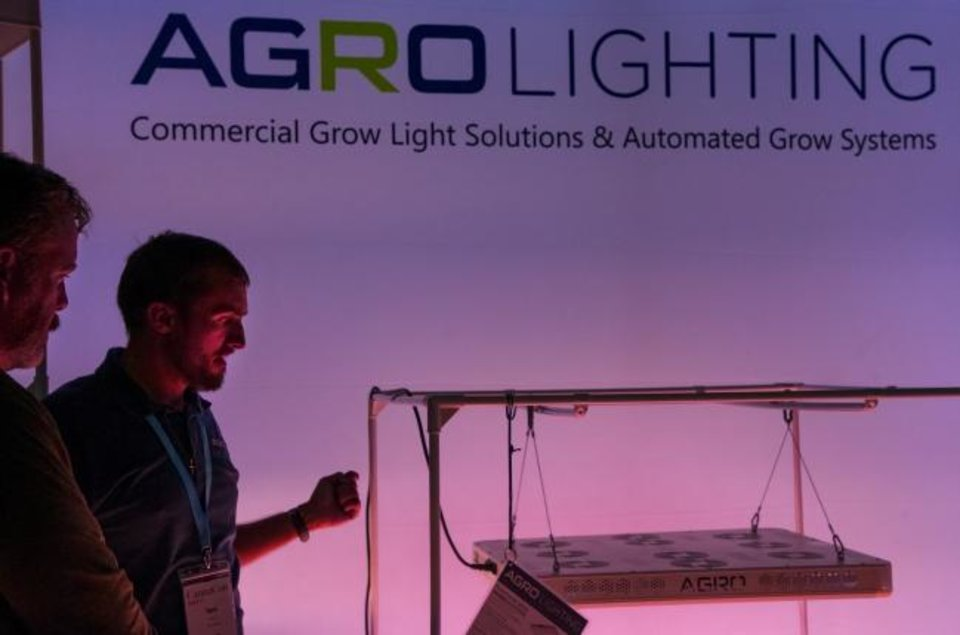 Photo -  Tom Wazny, of AGRO Lighting, speaks Friday about the products supplied by his company during the CannaCon convention. [CHRIS LANDSBERGER/THE OKLAHOMAN]