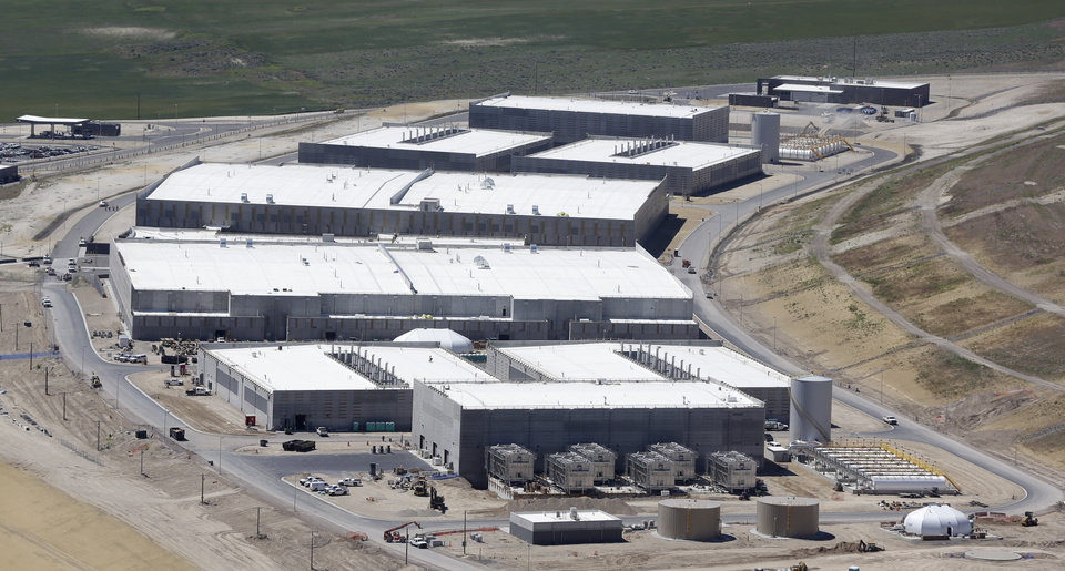 Photo - FILE - This June 6, 2013 file photo shows the National Security Agency's Utah Data Center in Bluffdale, Utah. Utah lawmakers are sending mixed messages to the NSA on the massive data-storage warehouse outside of Salt Lake City. One proposal calls for legislators to fulfill a promise not to collect utility taxes from the center. But a lawmaker wants to cut off water to the center, which uses more than 1 million gallons daily to cool its computer processors. Republican Rep. Marc Roberts of Santaquin says his proposal, still in the works, protects state rights and also defends Utah residents' right not to be spied on. (AP Photo/Rick Bowmer, File)